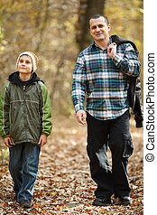Father and son taking a walk outdoor
