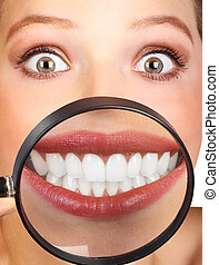 Woman teeth - Beautiful young woman teeth and magnifying...