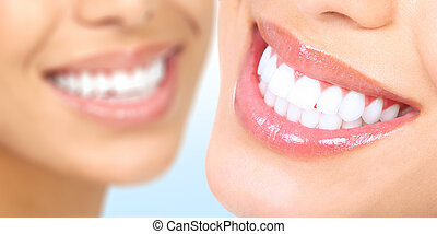 woman teeth - Beautiful young woman teeth Over blue...