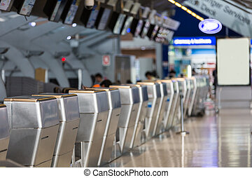 Row of empty check-in counter. - Row of empty check-in...