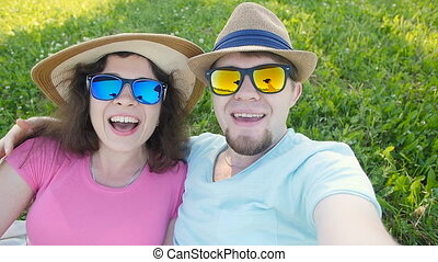 Young couple taking a selfie on a sunny day - Happy young...
