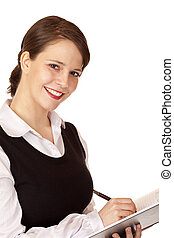 Attractive smiling business woman writes in schedule....