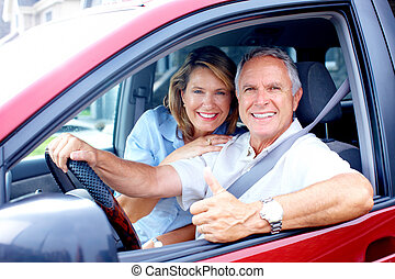 couple in the car - Smiling happy elderly couple in the car...