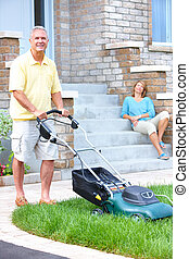 senior man - Smiling happy elderly senior man with lawnmover...