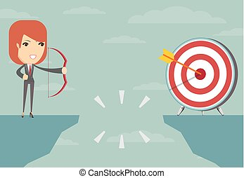 successful businesswoman aiming target