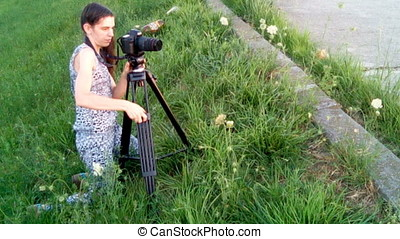 Young Woman Taking Pictures With Tripod At Sunset - Young...