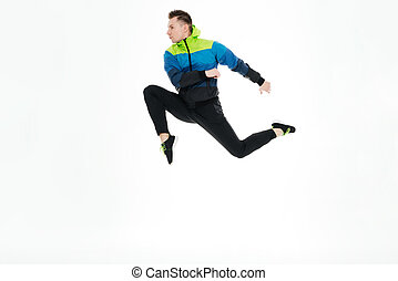 Strong sportsman jumping isolated over white background -...