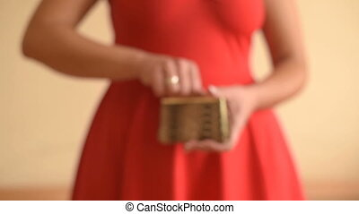 Empty purse in women's hands - Young woman shows her empty...