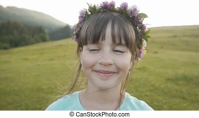 Girl with Wreath - Pportrait of cute young smiling girl with...