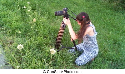 Photographer Woman Adjusting Tripod And Taking Pictures -...