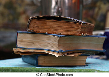 Old vintage books and booklets on table close up - Stack of...