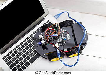 connected to a laptop via a wire robot on four wheels usb