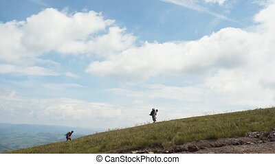 Travelers Climbing Mountain - Couple of travelers, man and...