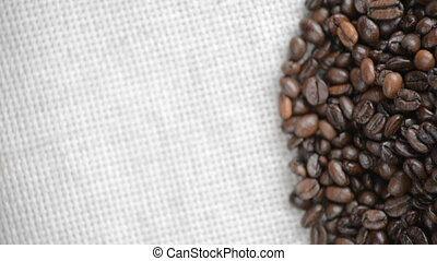 The coffee beans rotates on the turntable. - Coffee beans...