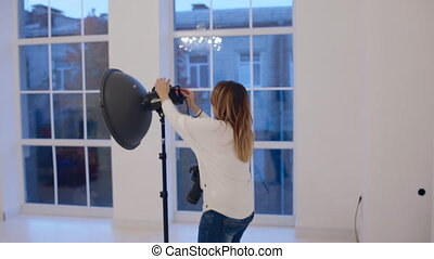 Photographer work with model in studio. Backstage.