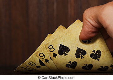 Vintage poker cards holded in a man hand - Vintage styled...