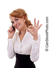 woman with phone and ok gesture