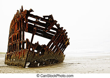 Old Shipwreck in Heavy Fog - The rusted frame of the wrecked...