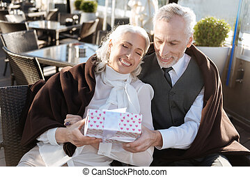 Joyful woman taking present box - All for you. Confident...