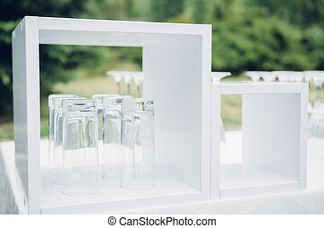Glasses on white table - Glasses on the white table in the...