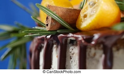 Cake decorated with rosemary, kumquat and gingerbread...