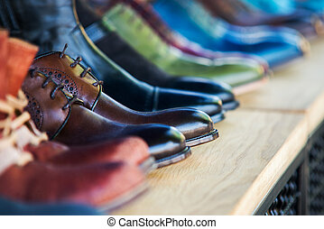 Close up on mens leather shoes in the row