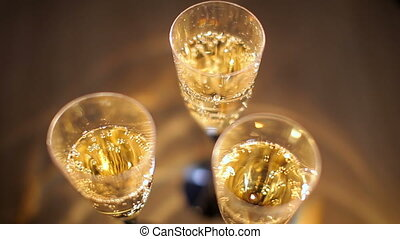 Glasses of sparkling wine on the table at the party