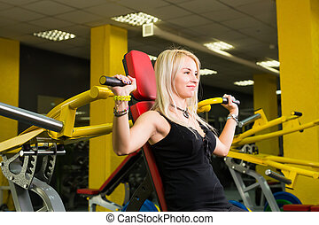 fitness, sport, powerlifting and people concept - Young woman weight training