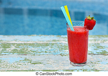 Strawberry smoothie on old rusric turquiose background near...