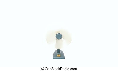 Retro electric fan blows cool air. Isolated on white...