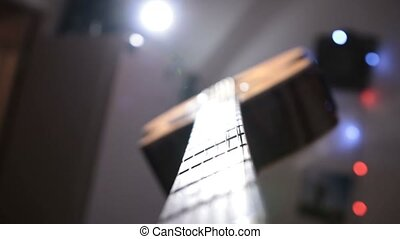 Musician playing acoustic guitar and singing - Closeup of...