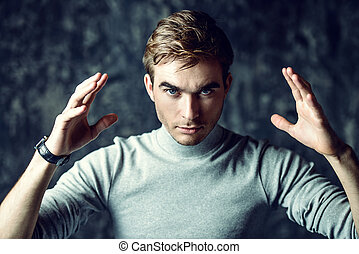 hypnosis psychological impact - A man with a serious look...