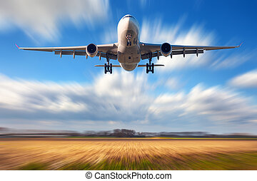 Airplane with motion blur effect. Landscape with passenger...