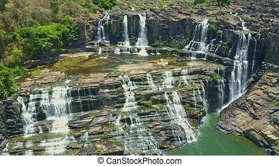 UAV Camera Hangs over Waterfalls Cascade among Rocks - UAV...