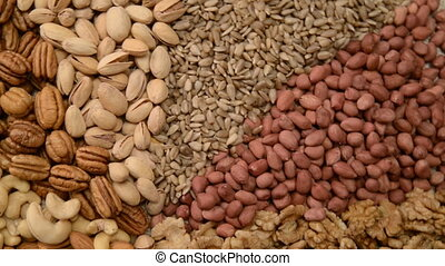 Nuts mix in a canvas bag in table. Ten kinds of nuts: pecan,...