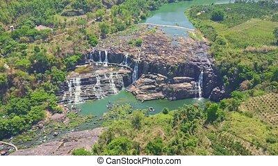 High Arial View Waterfalls Cascade among Jungle Highlands -...