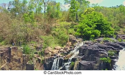 Drone Opens View of Waterfalls against Plants in Highland -...