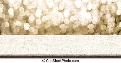 Empty marble table top with sparkling gold bokeh abstract...