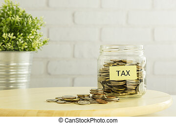Tax refund planning for saving money - Coins in saving money...