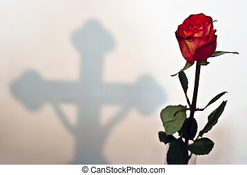 Rose to the Cross - red rose with a cross in the background...
