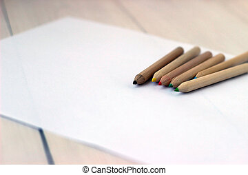 Color pencils on white paper, concept of drawing, close up -...