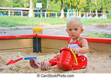 Little baby girl playing in sandbox - Little baby girl...