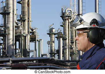 engineer and oil industry - engineer in hard-hat with large...