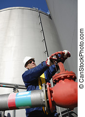 engineer turning pipeline pump - engineer in hard-hat...