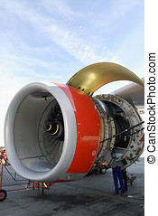 jet engine being repaired - mechanics servicing large...
