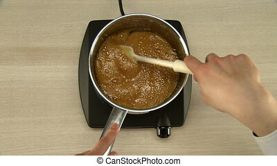 Cooking chocolate glaze. - Cooking chocolate glaze on...