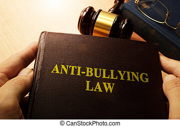 Anti-Bullying Law concept. - Hands holding Anti-Bullying Law...