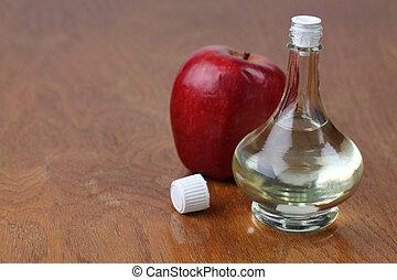 Apple vinegar - Bottle with apple vinegar and fresh apple....