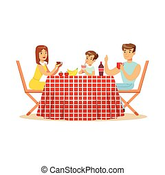 Happy family having lunch outdoors, mother, father and son...
