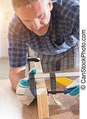 Man using bar clamp in a warkshop